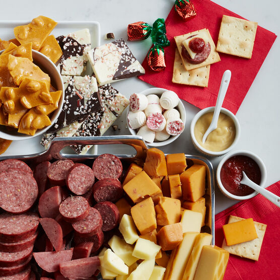 gift box includes a variety of sausage, cheese, mustard, mints, and peanut brittle