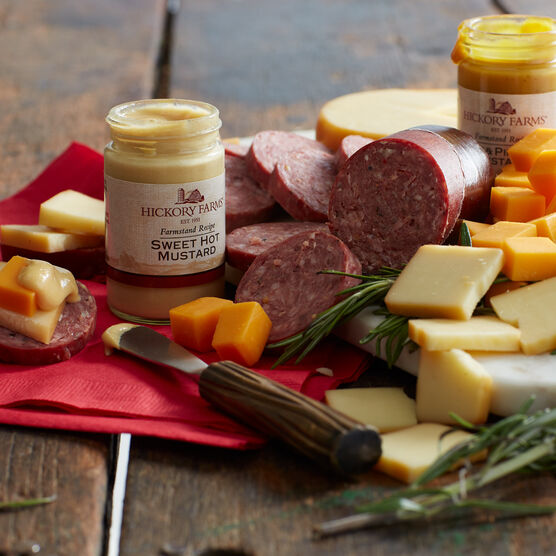 gift box includes beef summer sausage, various cheeses, and mustards