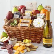 Spring Gift Basket includes sausage, cheese, a variety of fruit, nuts, mints, Mirassou Chardonnay and a flower cookie