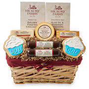 Festive Birthday Basket with beef summer sausage, various cheeses, crackers, and two cupcake cookies