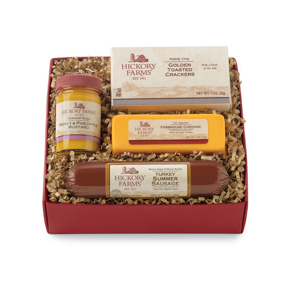 Hickory Farms Sampler Gift Box includes turkey summer sausage, mustard, cheese, and crackers