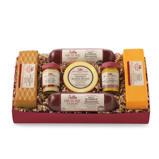 gift box includes mustard, summer sausage, and various cheeses