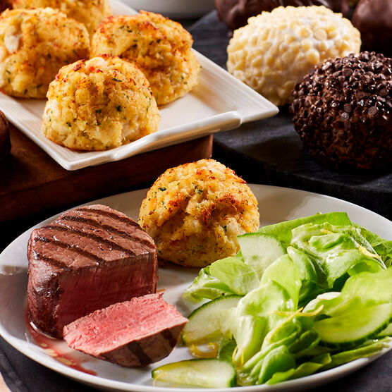 Our Three Course Dinner includes crab cakes, filet mignon, and Italian ice cream truffles
