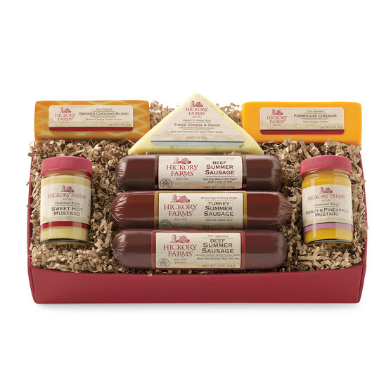 warm and hearty welcome gift box includes sausage, cheese, mustard, and various cheeses