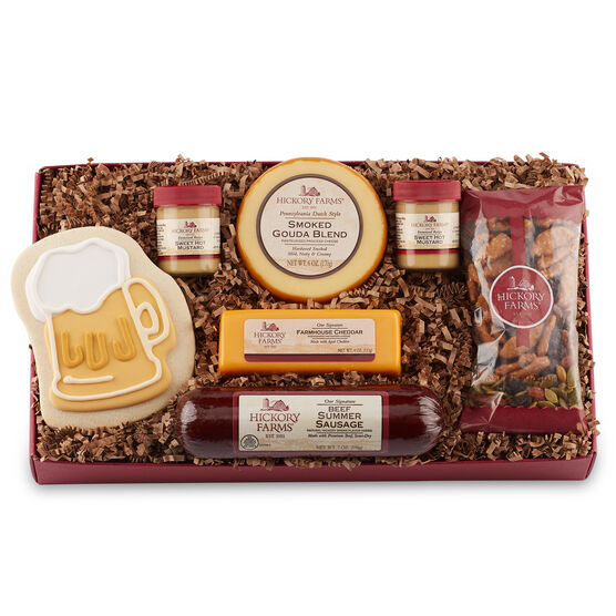 Father's Day Cravings Assortment includes Signature Beef Summer Sausage, Smoked Gouda Blend, Farmhouse Cheddar, Cranberry & Sesame Nut Mix, Sweet Hot Mustard, and a beer stein cookie.