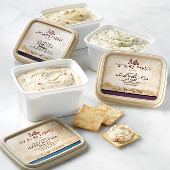 flight includes garlic mozzarella, garden vegetable, and pepper jack cheese spreads