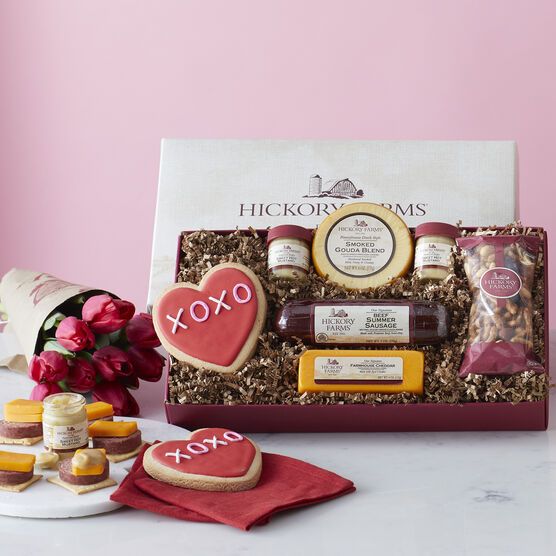 Gift box includes summer sausage, cheese, mustard, nuts, and a valentine's day cookie