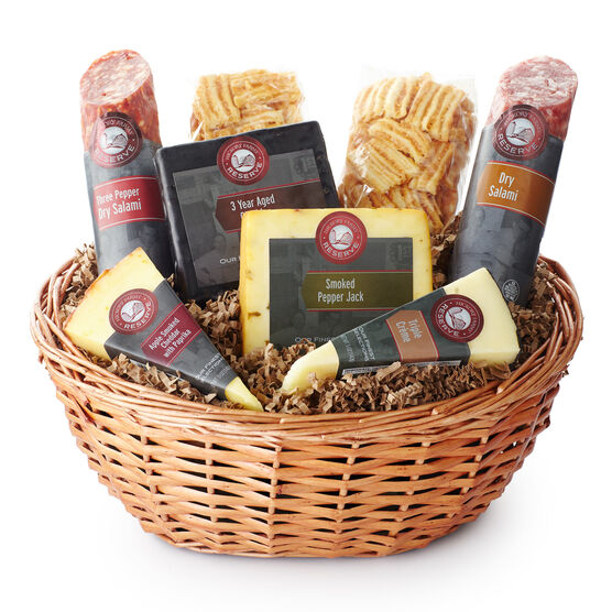 Gift basket includes dry salami, artisan cheeses, and cheese crisps