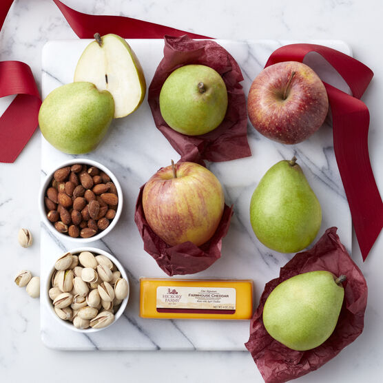 Fruitful Gift Box includes, cheese, pistachios, mixed nuts, apples, and pears