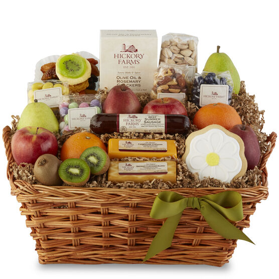 Bountiful Spring Tastings Basket includes summer sausage, cheese, fruit, nuts, crackers, and a flower cookie