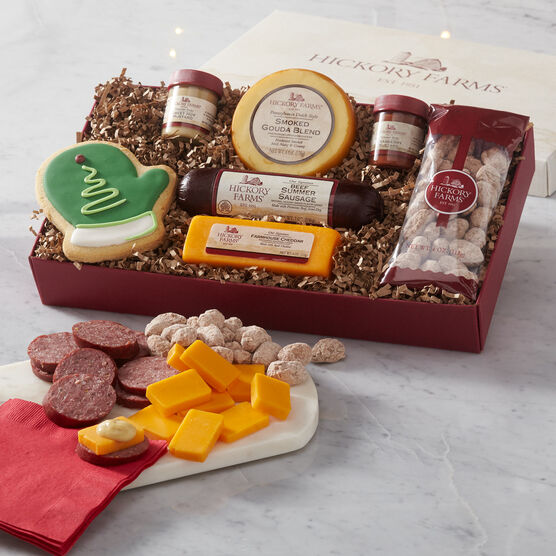 Holiday Cravings Assortment Gift Box includes summer sausage, cheese, nuts, and pretzels