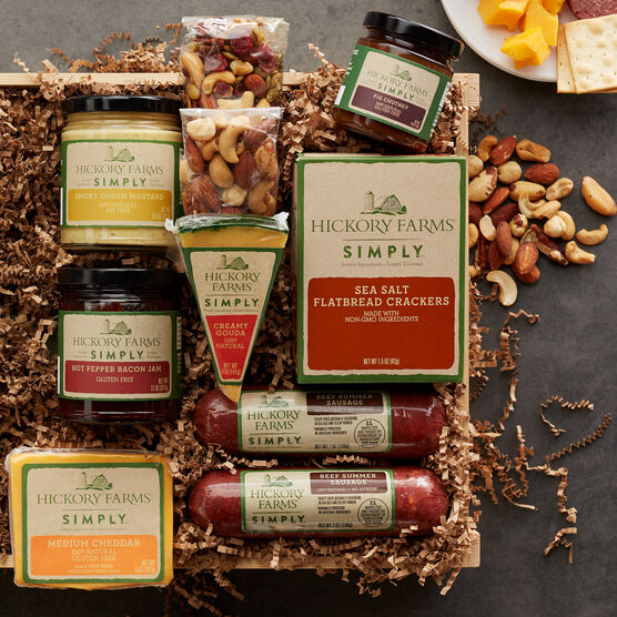 simply deluxe gift crate includes various sausages, cheeses, nuts, crackers, and spreads