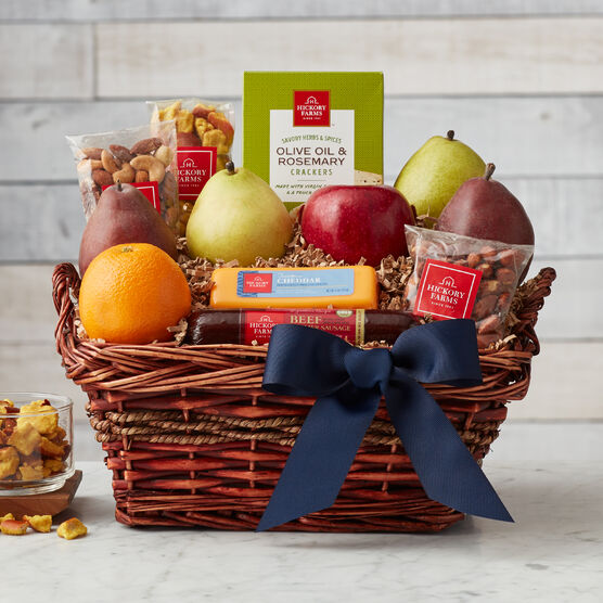 This Father's Day gift basket is filled with snacks Dad will love to dig into! Summer sausage, cheese, fresh fruit, nuts, and crackers all pair deliciously and let him create his favorite flavor combinations.