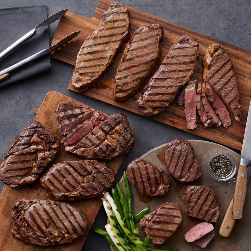 The Deluxe Assortment includes filets, New York strip steaks, and boneless ribeye steaks