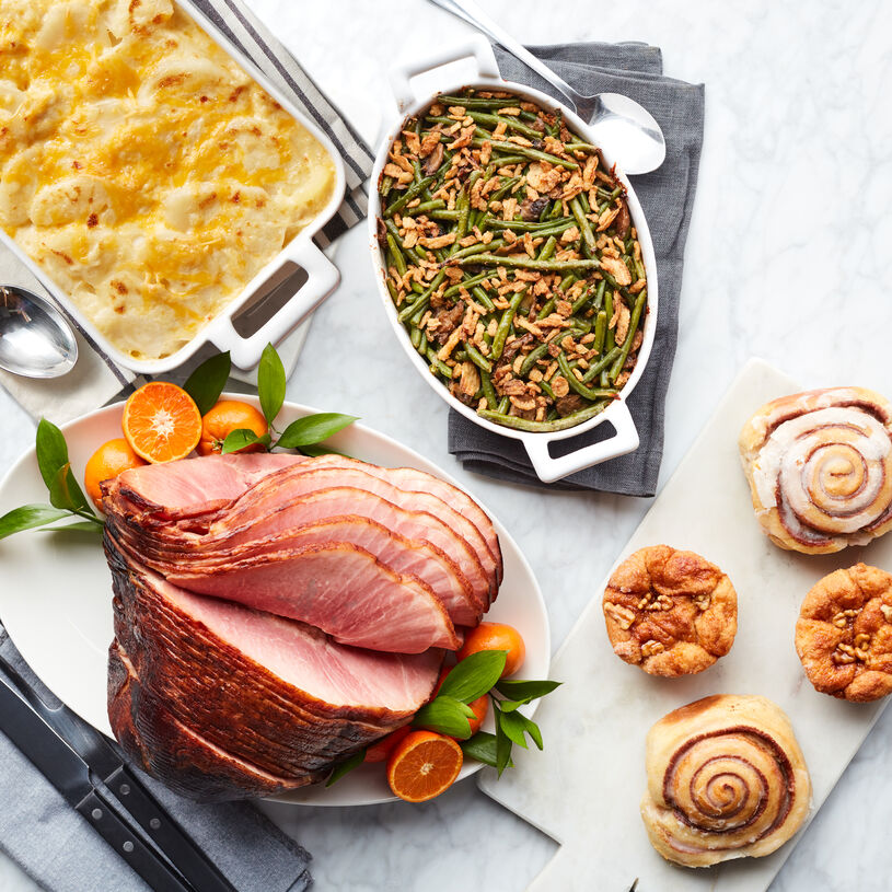 This meal includes HoneyGold Spiral Sliced Ham, Scalloped Potatoes, Green Bean Casserole, Cinnamon Buns & Cinnamon Pull-Apart Rolls.