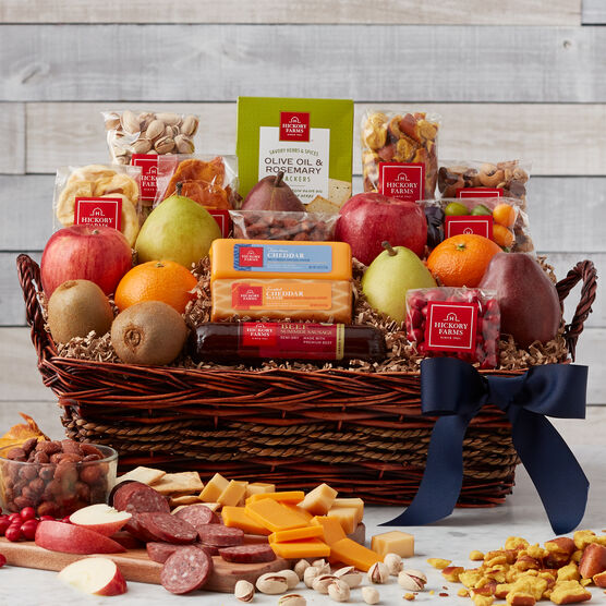 This Father's Day basket includes fruits, nuts, meats, cheese, crackers, and a cookie.