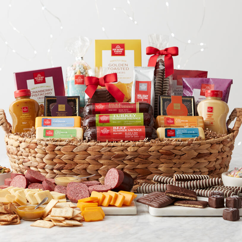 This impressive gift basket includes a variety of sausage, cheese, crackers, mustards, sweets, and coffee.