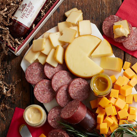 gift box includes summer sausage, mustard, and various cheeses