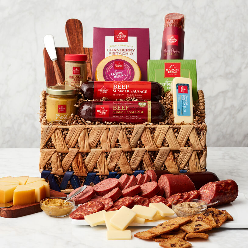 This basket includes summer sausages, salami, creamy cheeses, mustard flavor, Cranberry Pistachio Crisps, mini cheese board and cheese spreader.