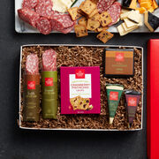 Reserve dry salami, creamy cheeses, and delicious Cranberry Pistachio Crisps pair perfectly for a unique and savory experience.