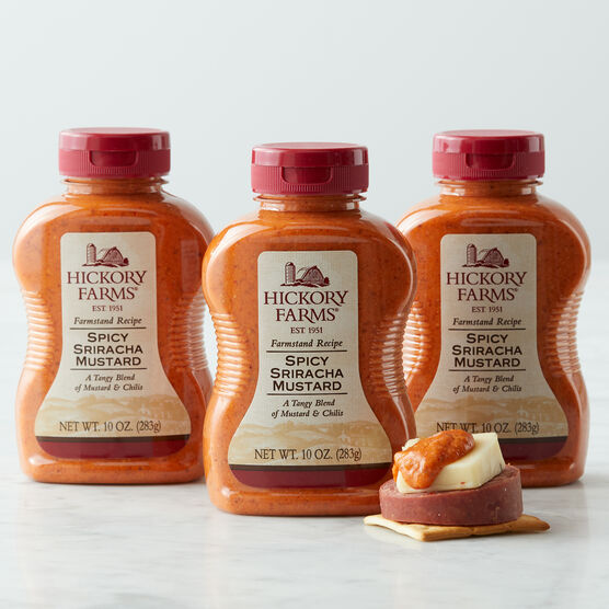 ur Spicy Sriracha Mustard is an expertly crafted blend of tangy mustard and spicy, smoky chilis that's perfect for pairing with your favorite cheeses and sausage.