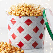 A delectable sampling of Sweet & Salty Kettle Corn, Premium Caramel Corn, and White Cheddar Popcorn that's perfect for sharing at holiday parties.
