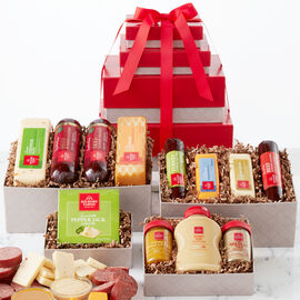 This savory gift starts with an assortment of Hickory Farms classics, Signature Beef Summer Sausage and cheeses. Next is a box of bold flavors like Turkey and Spicy Summer Sausages, Horseradish Cheese, and Farmhouse Cheddar, and spreadable cheese.