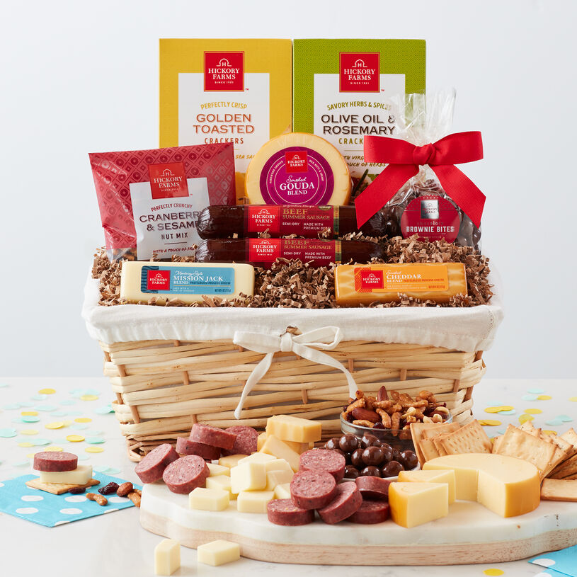 Birthday Wishes Gift Basket with beef summer sausage, various cheeses, crackers, nuts, and brownie bites.