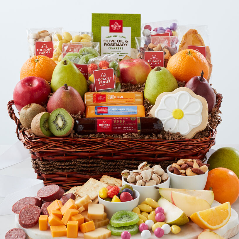 Bountiful Spring Gift Basket includes summer sausage, cheese, fruit, nuts, crackers, and a flower cookie