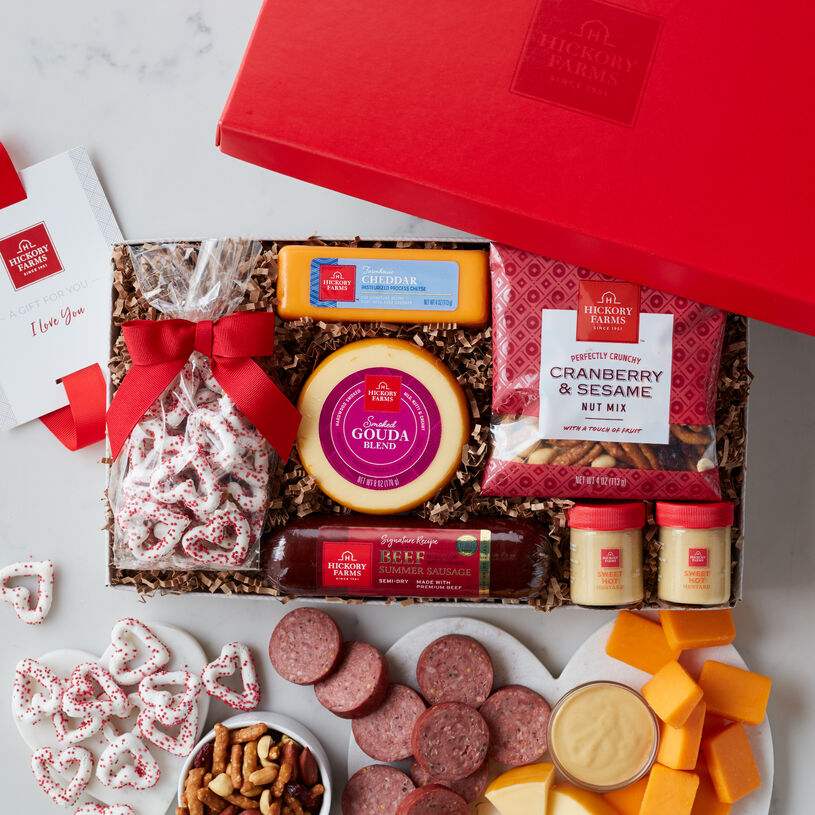 Valentine's Day Gift box includes summer sausage, cheese, mustard, nuts, and valentine's day pretzels.