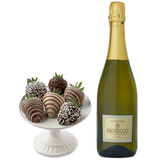 This gift box has strawberries dipped in dark, milk, and white chocolate, and a bottle of La Fornarina Prosecco.