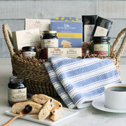 Everything is this brunch basket is carefully packed in a chic reusable basket with a pretty tea towel.