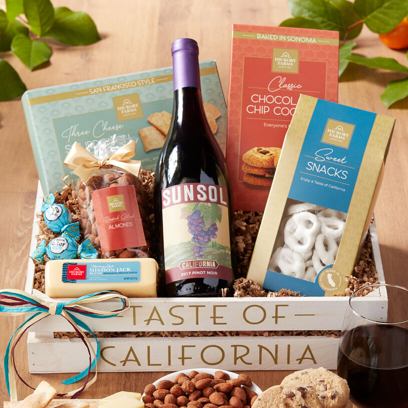 This wine gift crate includes creamy cheese, Sourdough Crackers, Chocolate Chip Cookies, nuts, pretzels, Alter Eco organic Silk Velvet Truffles, and SunSol California Pinot Noir.