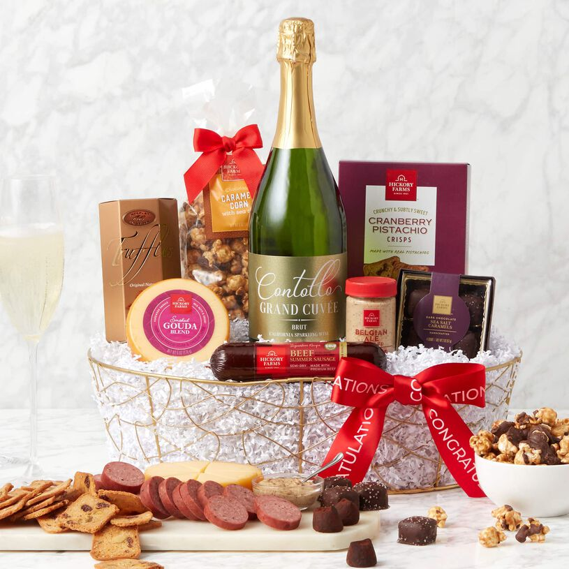 Celebrate an accomplishment or a job well done with this gourmet congratulations wine gift basket delivered right to their door!