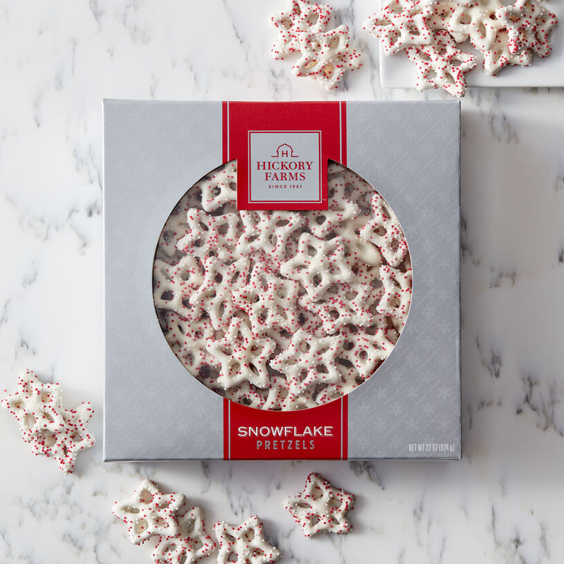 Delicate snowflake-shaped pretzels drenched with creamy white confection and sprinkled with miniature nonpareils.