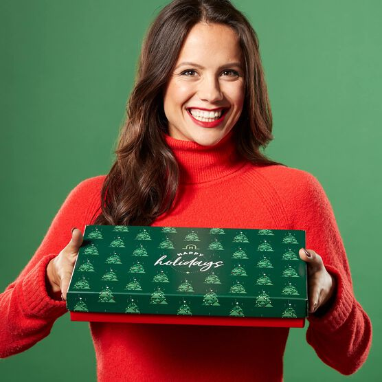 Happy Holiday's Mailer Held By Model