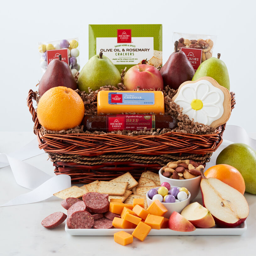 Spring Snack Gift Basket includes sausage, cheese, fruit, crackers, nut mix, alpine mints, and a flower cookie