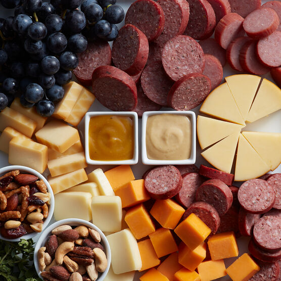 Alternate view of the Give Back Gift Box which includes various sausage, cheeses, and nuts