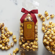 We start with crispy popcorn and coat with sweet toffee.