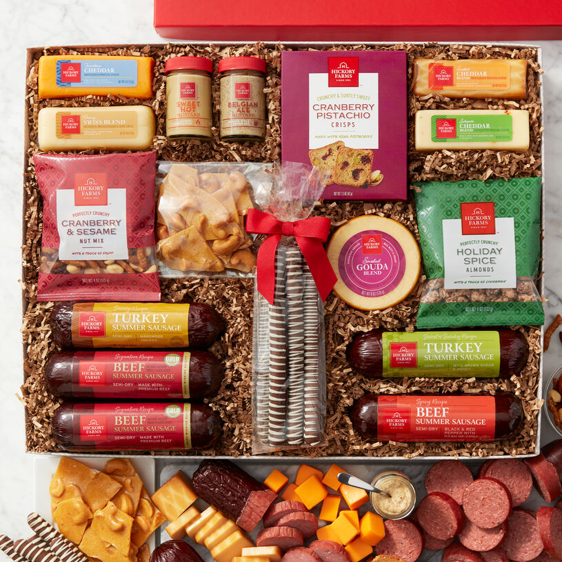 Two Signature Beef Summer Sausages, Spicy Beef, Sweet & Smoky Turkey, and Savory Turkey Summer Sausages, five gourmet cheeses, two of our famous mustards, and Cranberry Pistachio Crisps and nuts.