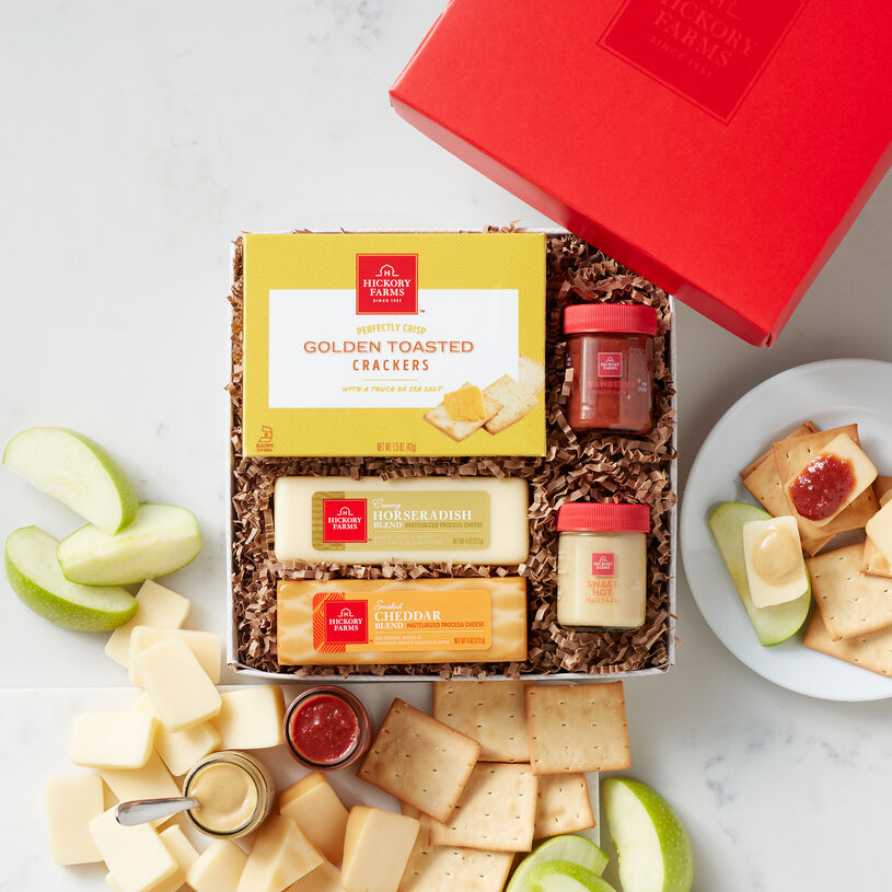 Featuring smoked cheddar and horseradish cheeses, Cranberry and Sweet Hot Mustards, and Naan Crisps, this gift lets you stack up tasty bites for the perfect snack