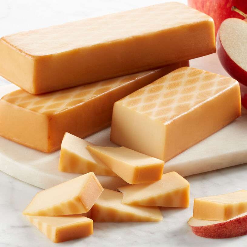 Imagine the sharp flavor of aged cheddar mellowed by the tang from a touch of Swiss cheese.