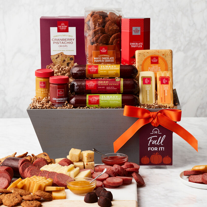 This fall gift basket is filled with savory meat and cheese, mustards, crisps, Spiced Pumpkin Cookies, and Belgian-Style Chocolate Truffles.