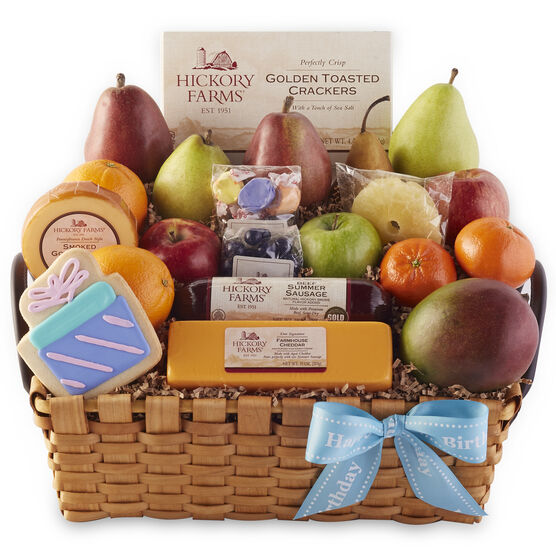 Happy Birthday Basket with a variety of fruit, summer sausage, cheese, and candy