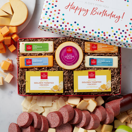 This birthday box is filled with our party size Signature Beef Summer Sausage, Smoked Gouda, Smoked Cheddar, Jalapeno & Cheddar Blend, Farmhouse Cheddar, Mission Jack Blend, and Golden Toasted Crackers.