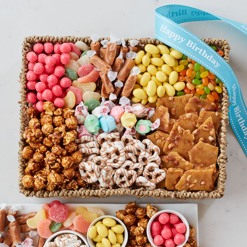 Birthday Sweets Basket includes caramel pretzels, peanut brittle, gummies, sour candy, and salt water taffy