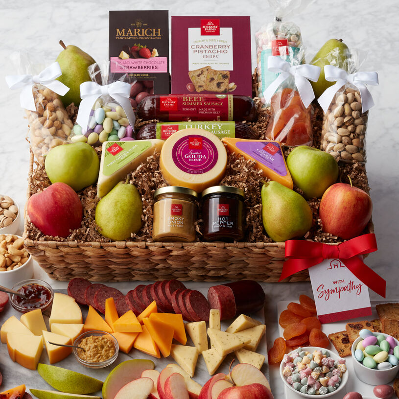 Show your support through difficult times with this bountiful sympathy gift basket filled with sweet and savory treats.