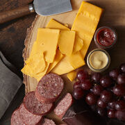 Assortment includes beef summer sausage, farmhouse cheddar cheese, sweet hot mustard, and cranberry mustard