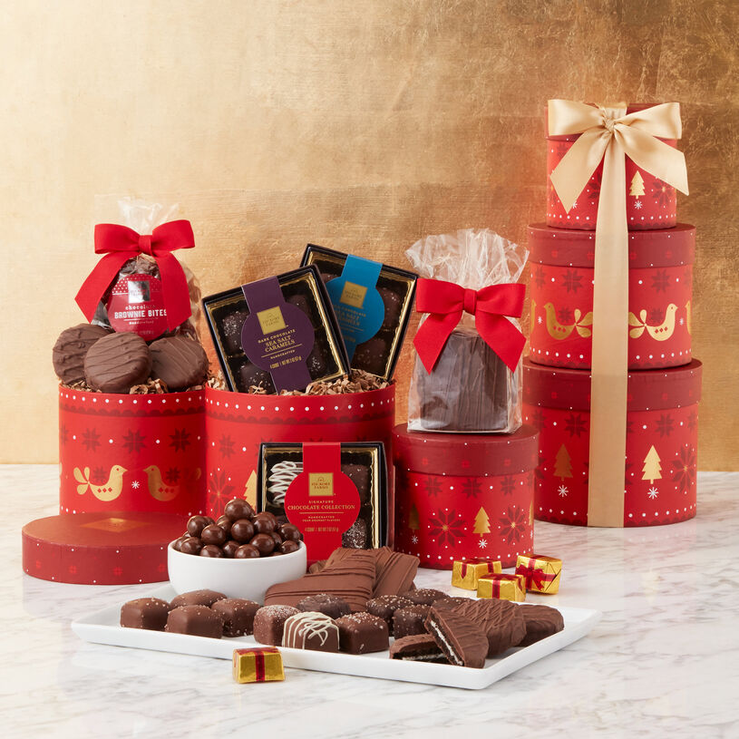 Gift includes our Signature Chocolate Collection, Milk Chocolate Sea Salt Caramels, Dark Chocolate Sea Salt Caramels, Brownie Bites, Chocolate Covered Grahams, and Chocolate Sandwich Cookies.