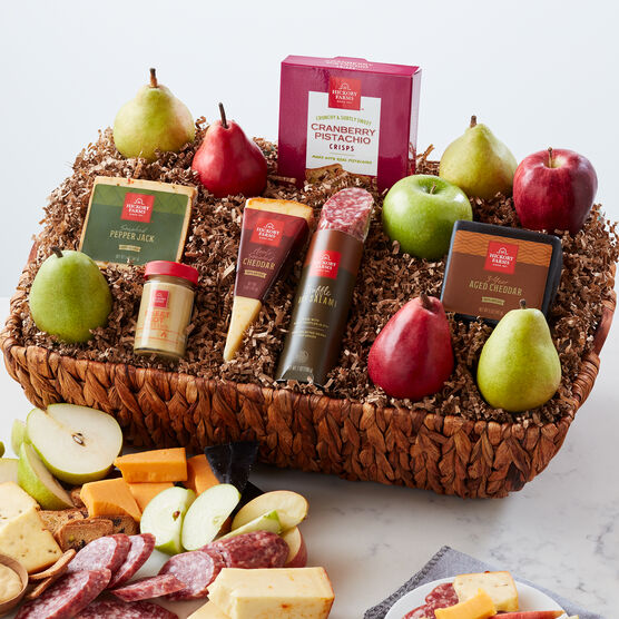The Gourmet Entertainment Gift Basket includes pears, apples, salami, cheese, and crisps.